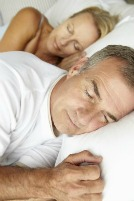 Sleeping couple take melatonin supplement to heal vertigo