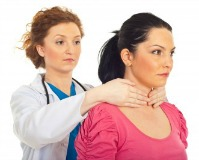 doctor checking woman for low thyroid function symptoms